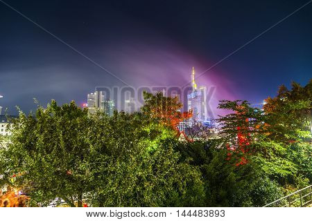 Skyline Of Frankfurt With Light Installations In The Trees At  The Museum Festival In Frankfurt
