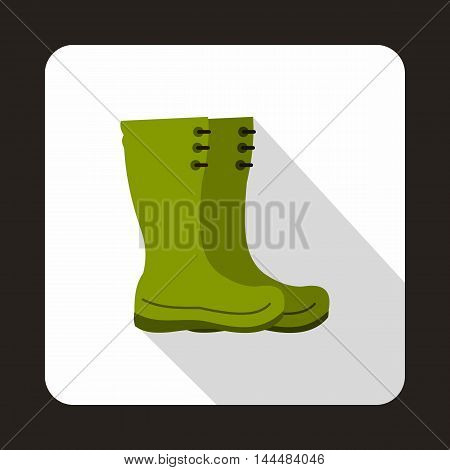 Green rubber boots icon in flat style with long shadow