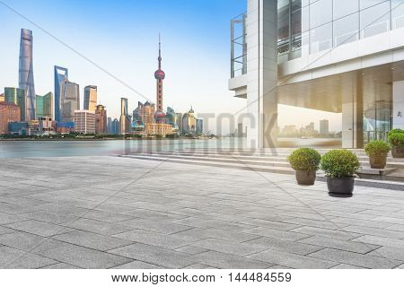 abstract building wall with city skyline background,shanghai,china.