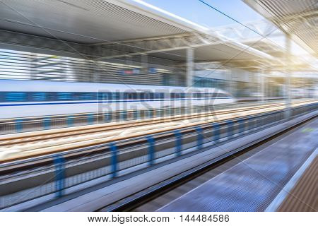 high-speed rail arriving at station