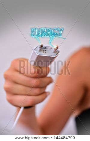 Power in hand with text and electric plug