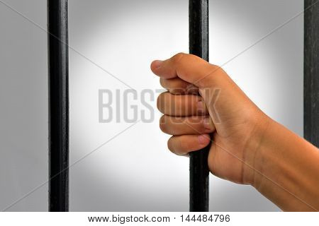 hand of a person locked up wanting out