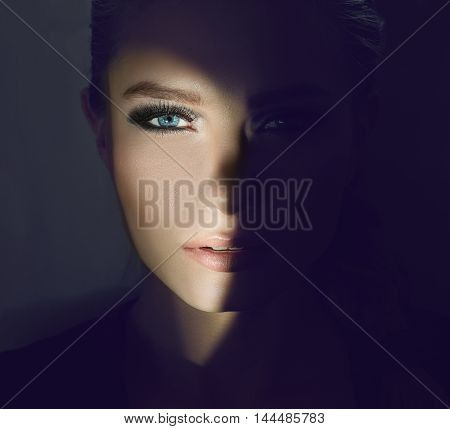 girl's face in the twilight with the lit right cheek