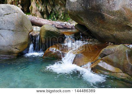 Small wonderful refreshing waterfalls among the rocks