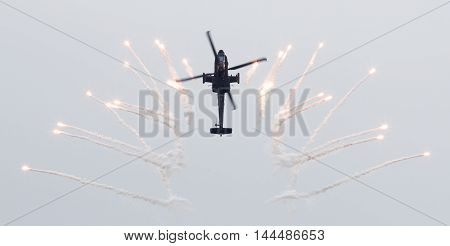 Leeuwarden, The Netherlands - Jun 11, 2016: Dutch Ah-64 Apache Attack Helicopter Firing Off Flares D