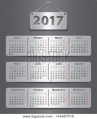 Calendar for 2017 in Spanish with attached metallic tablets. Vector illustration