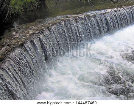 Beautiful waterfall in riverside detail (Mosteiro - Portugal)