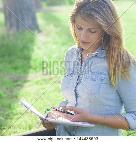 Young Woman Studing In The Park