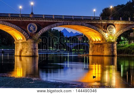 Turin (Torino) beautiful scenery at twilight with river Po Ponte Isabella and Monviso