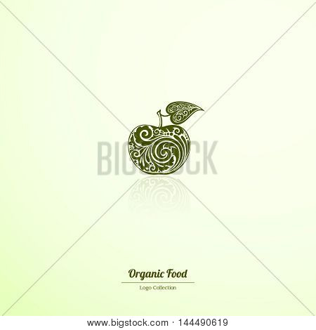 Ornate apple with a leaf icon logo label. Vector design