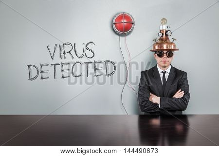 Virus detected text with vintage businessman and alert light