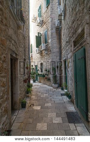 KOTOR MONTENEGRO - 12TH AUGUST 2016: Streets of Old Town Kotor during the day showing the outside of buildings.