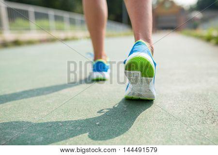 Woman training marathon in a city
