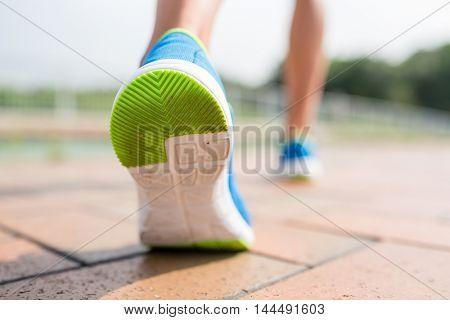 Woman running at city