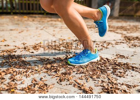 Woman run in a park at outdoor