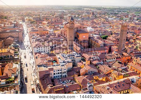 Aerial cityscape view from the tower on Bologna old town with San Pietro cathedral in Italy