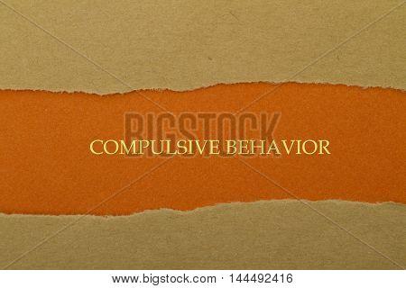 Compulsive Behavior written under torn paper .