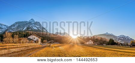 Mountain village at the foot of the Austrian Alps - Beautiful mountain landscape with a small village called Ehrwald located at the foot of the Austrian Alps under a clear blue sky and a gorgeous sun.