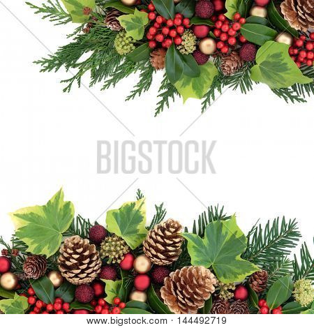 Christmas border with red and gold bauble decorations, holly, ivy, pine cones, cedar cypress and fir leaf sprigs over white background.