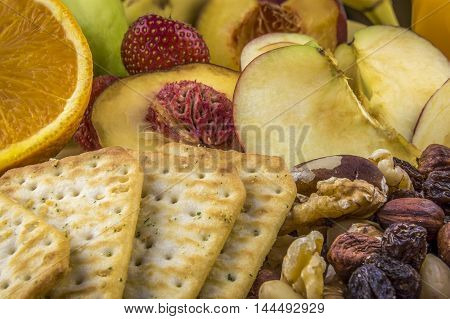 Snacks background, fruits, nuts, crackers  - Background image with snacks healthy fruits and nutritious nuts and crackers.