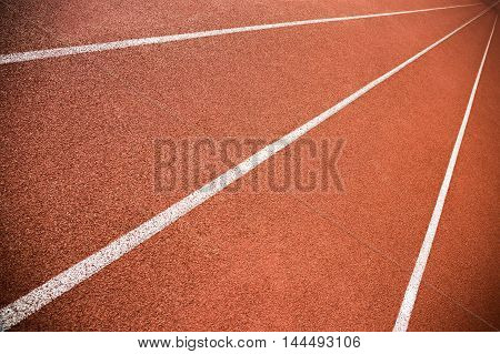 Empty red lanes on a running track