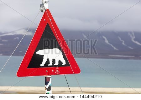 Warning sign for polar bears at Spitsbergen, Svalbard, Norway.