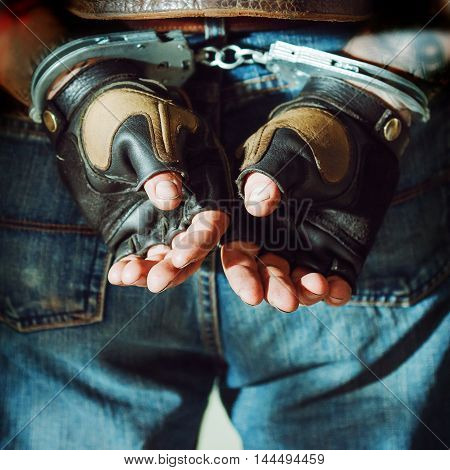 Criminal man. Male hands in the handcuffs