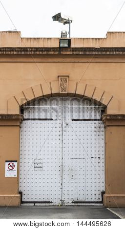 Adelaide South Australia, Australia - August 14 2016: One of the large wooden doors viewed from the outside of the old historic Adelaide Gaol Adelaide South Australia