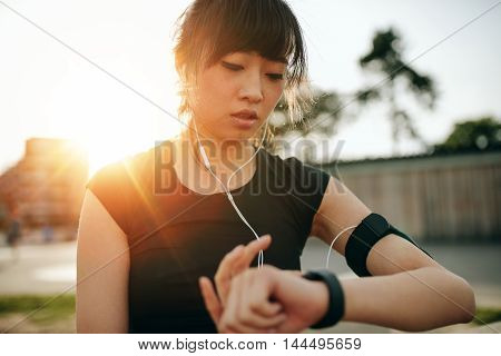 Woman Monitoring Her Progress On Smartwatch
