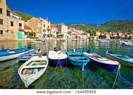Komiza on Vis island turquoise waterfront boats and town view Dalmatia Croatia