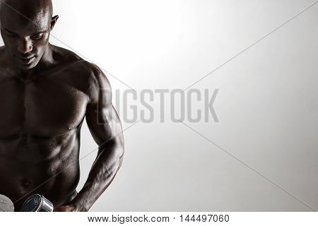 Healthy Muscular Young Man Holding Dumbbells