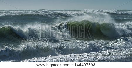 Ocean waves in New Zealand on a sunny day