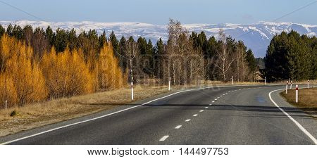 Autumn road in New Zealand, mountains on background