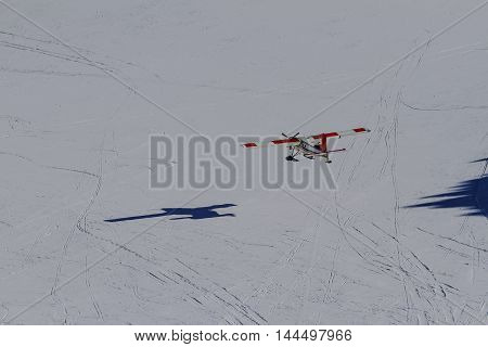 Cessna plane flying on snow background, New Zealand