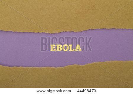 Ebola word written under torn paper .