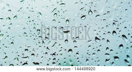 Rainy wet cold blue sky eco seasonal natural abstract background with water drops