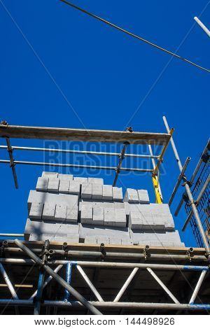 Pile of 'Aircrete' concrete blocks. On a house building site. In England