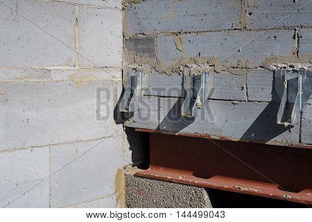 Galvanised joist hangers within interior of house build in progress.