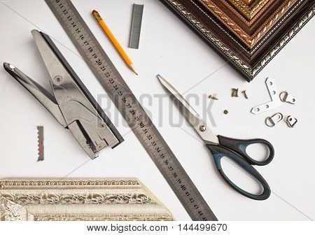 Accessories For Picture Framing Studio On A White Background