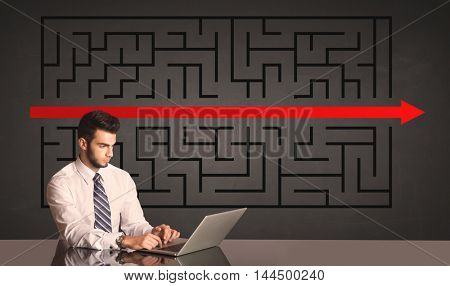 Successful businessman with a solved puzzle in background