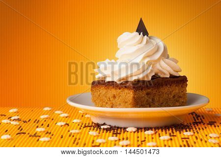 Close up of a delicious cake on colorful background with copyspace