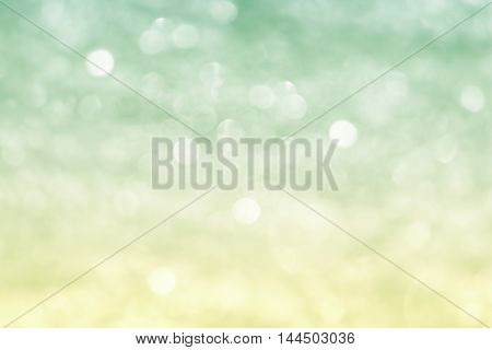 abstract festival background with defocused lights. bio colors light green-yellow.