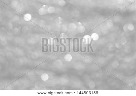 abstract festival background with defocused lights. black and white.