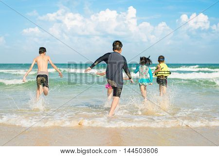 Kids playing on the beach at summer time.