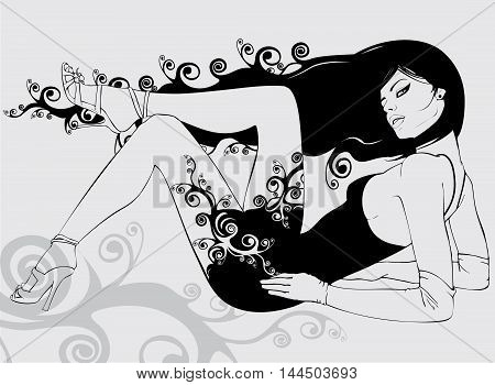 A beautiful girl with long black hair. It was wearing a dress, shoes and gloves. Lies in the relaxed posture.