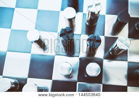 Black & chrome metallic chess on board. Business concept: Market competition and usurp business opportunities.