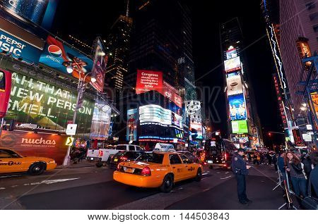 New York City USA - November 20 2011: Illuminated facades of Broadway with busy traffic and commercial atmosphere at night Times Square in Midtown Manhattan is a symbol of New York City and the United States.