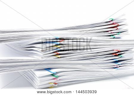 Pile Of Workload Paperwork On White Background