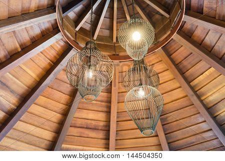 Ceiling lamps for interior decoration with wooden circle roof.