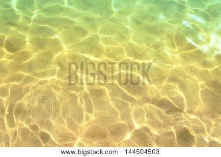 Close-up Of Shining Sea Water On Gold Sand Beach. Koukounaries Beach. Skiathos Island, Sporades Arch